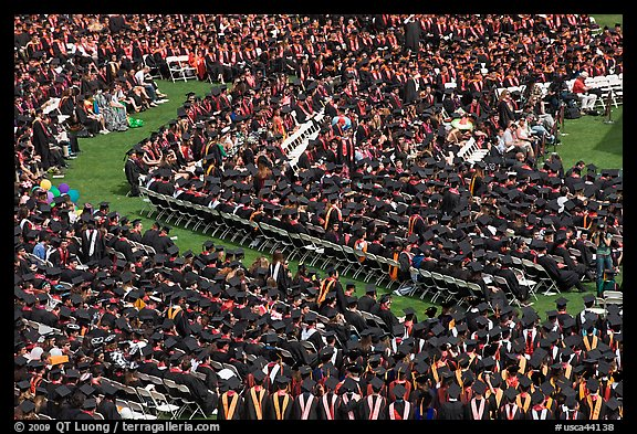 Large gathering of students in academic dress at graduation ceremony. Stanford University, California, USA (color)