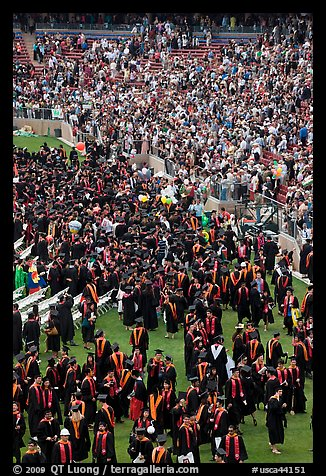 Graduates gather in front of family and friends after commencement. Stanford University, California, USA (color)