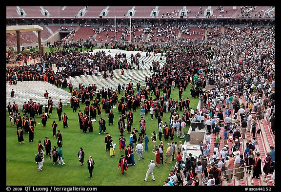 Audience and graduates mingling in stadium after commencement. Stanford University, California, USA (color)