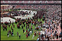 Audience and graduates mingling in stadium after commencement. Stanford University, California, USA ( color)