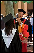 Faculty in academic dress talks with student. Stanford University, California, USA ( color)