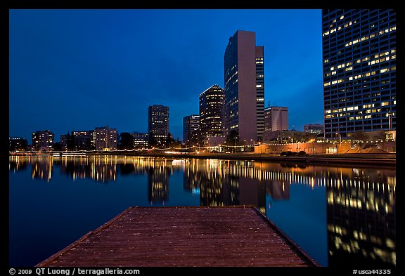 High-rise buildings, deck, and Lake Meritt, dusk. Oakland, California, USA (color)