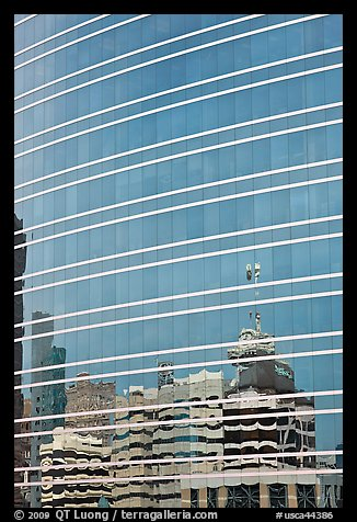 Federal building reflected in glass facade. Oakland, California, USA (color)