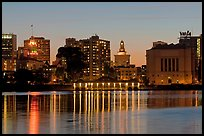 Downtown skyline accross Lake Merritt at dusk. Oakland, California, USA ( color)