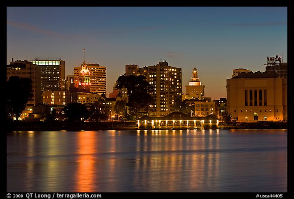 Oakland skyline reflected in Lake Merritt at night. Oakland, California, USA (color)