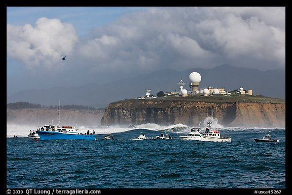 Flottila of boats near Mavericks break in front of Pillar Point radar station. Half Moon Bay, California, USA (color)