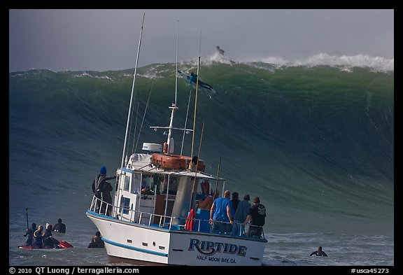 Judging boat with huge wave and surfer at crest. Half Moon Bay, California, USA (color)