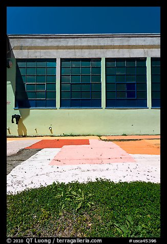 Sidewalk and industrial building facade. Berkeley, California, USA (color)