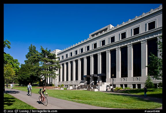 Students biking in front of Life Sciences building. Berkeley, California, USA (color)