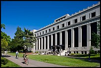 Students biking in front of Life Sciences building. Berkeley, California, USA ( color)
