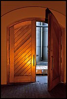 Wooden door opening to wine storage tanks. Napa Valley, California, USA (color)