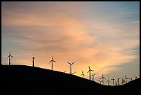 Wind farm silhouetted on hill, Altamont. California, USA (color)