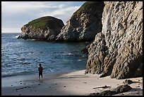 Boy standing at the base of bluff, China Cove. Point Lobos State Preserve, California, USA ( color)
