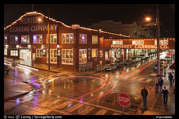 Monterey Canning company building and streets at night. Monterey, California, USA (color)