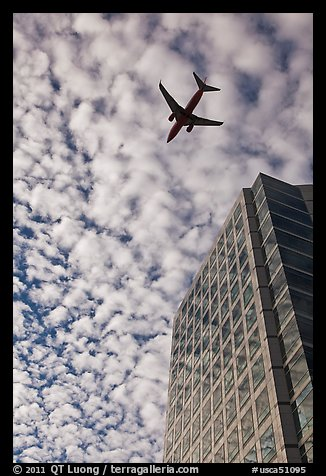 Adobe Tower and commercial aircraft. San Jose, California, USA (color)