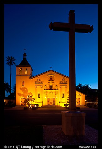 Cross and Santa Clara Mission at dusk. Santa Clara,  California, USA (color)