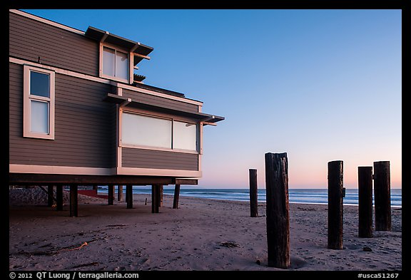 Pilings and beach house at sunset, Stinson Beach. California, USA (color)