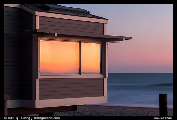 Sunset reflected in beach house window, Stinson Beach. California, USA (color)