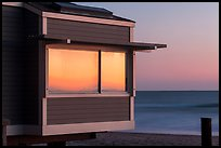 Sunset reflected in beach house window, Stinson Beach. California, USA ( color)