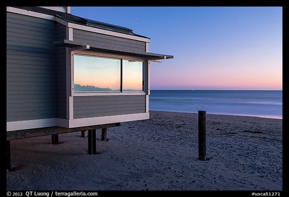 Modern beach house with large window reflecting sunset, Stinson Beach. California, USA (color)