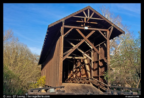 Brown truss covered bridge over the San Lorenzo River, Felton. California, USA (color)
