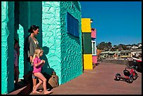 Family steps out of colorful cottage. Capitola, California, USA ( color)