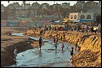 Children playing in tidal stream. Capitola, California, USA
