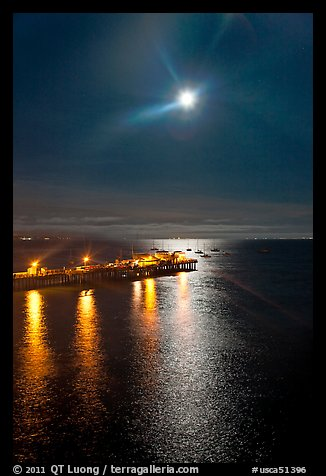 Moon and fishing pier by night. Capitola, California, USA (color)