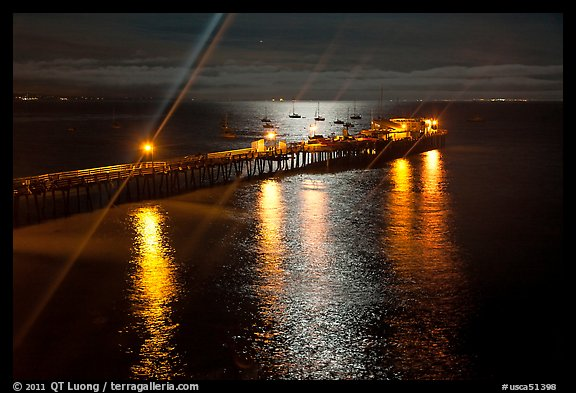 Wharf with moon reflections and light rays. Capitola, California, USA (color)
