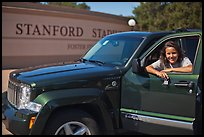 Student with new car. Stanford University, California, USA (color)