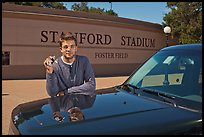 Student showing car keys. Stanford University, California, USA (color)