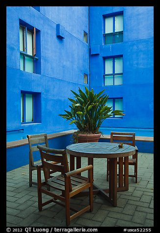Tables and chairs in blue courtyard, Schwab Residential Center. Stanford University, California, USA (color)