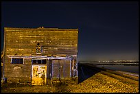 Shack, rails, and bay by night, Alviso. San Jose, California, USA (color)
