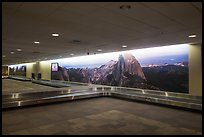 Baggage claim area with Yosemite murals, Fresno Yosemite Airport. California, USA ( color)