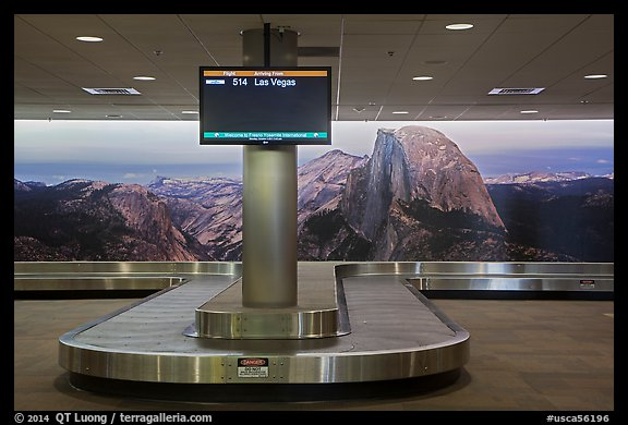 Baggage claim area and Half-Dome mural, Fresno Yosemite Airport. California, USA (color)