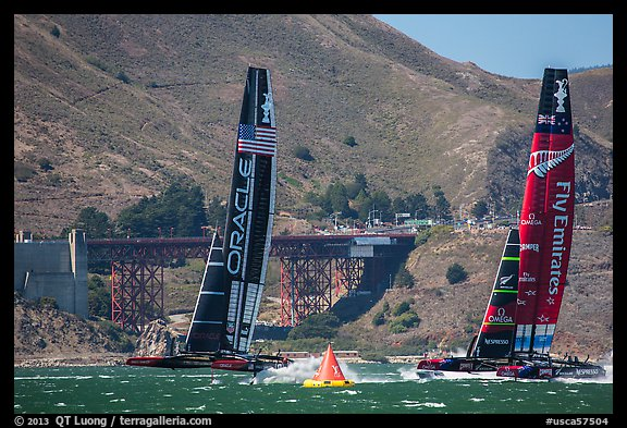 Emirates Team New Zealand leeward of Oracle Team USA at first mark. San Francisco, California, USA (color)