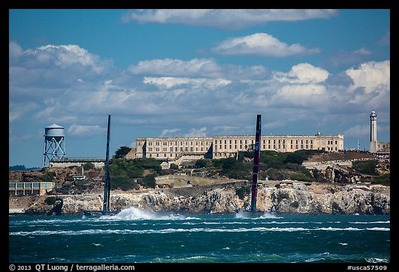America's cup catamarans in front of Alcatraz Island. San Francisco, California, USA (color)