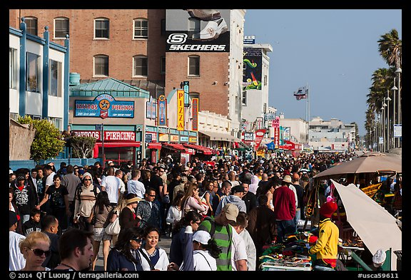 Ocean Front Walk with throngs of people. Venice, Los Angeles, California, USA (color)