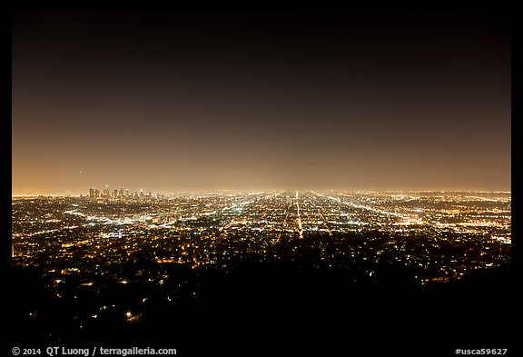 Lights of street grid and downtown at night from Griffith Park. Los Angeles, California, USA (color)