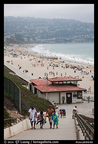 Beachgoers walking up from beach, Redondo Beach. Los Angeles, California, USA (color)