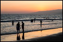 Sunset with beachgoers in water. Santa Monica, Los Angeles, California, USA ( color)