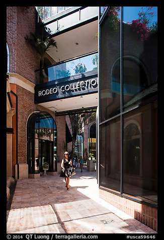 Woman walks in Rodeo Collection shopping area. Beverly Hills, Los Angeles, California, USA (color)