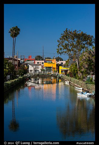 Brightly painted houses along canal. Venice, Los Angeles, California, USA (color)