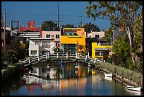 Rower under bridge next to colorful houses. Venice, Los Angeles, California, USA ( color)