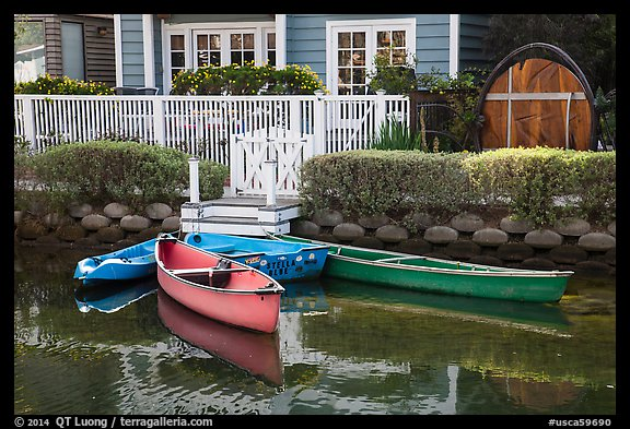 Rowboats in front of house, Venice Canal Historic District. Venice, Los Angeles, California, USA (color)