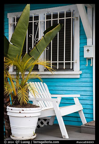 Matching white garden chair, flower pots, and window on porch. Venice, Los Angeles, California, USA (color)
