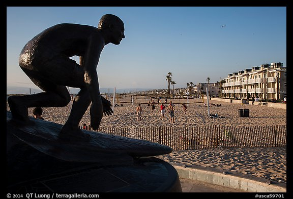 Statue of surfer and lifeguard Tim Kelly, Hermosa Beach. Los Angeles, California, USA (color)