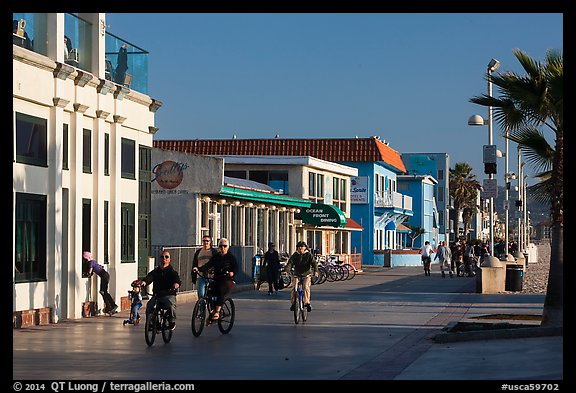 Riding bicycles on beachfront promenade, Hermosa Beach. Los Angeles, California, USA (color)