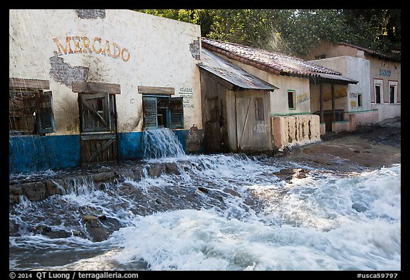 Adobe buildings and artificial flood, Universal Studios. Universal City, Los Angeles, California, USA (color)