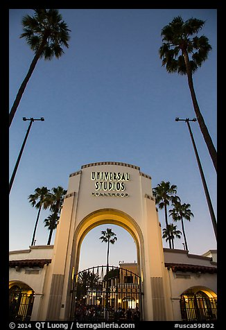 Entrance gate at dusk, Universal Studios. Universal City, Los Angeles, California, USA (color)